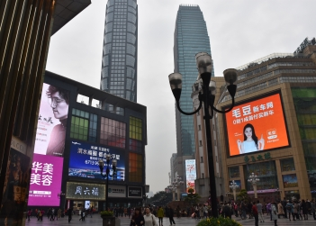 Associate Professor Ian McArthur is exploring the use of urban screens in Chongqing, China. Jiefangbei CBD, its central business district, centred on a large pedestrian mall surrounded by skyscrapers. Photo: Ian McArthur