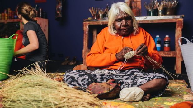 Songlines at the National Museum of Australia Indigenous artist Nola Taylor demonstrating traditional weaving. Photo: Rohan Thomson