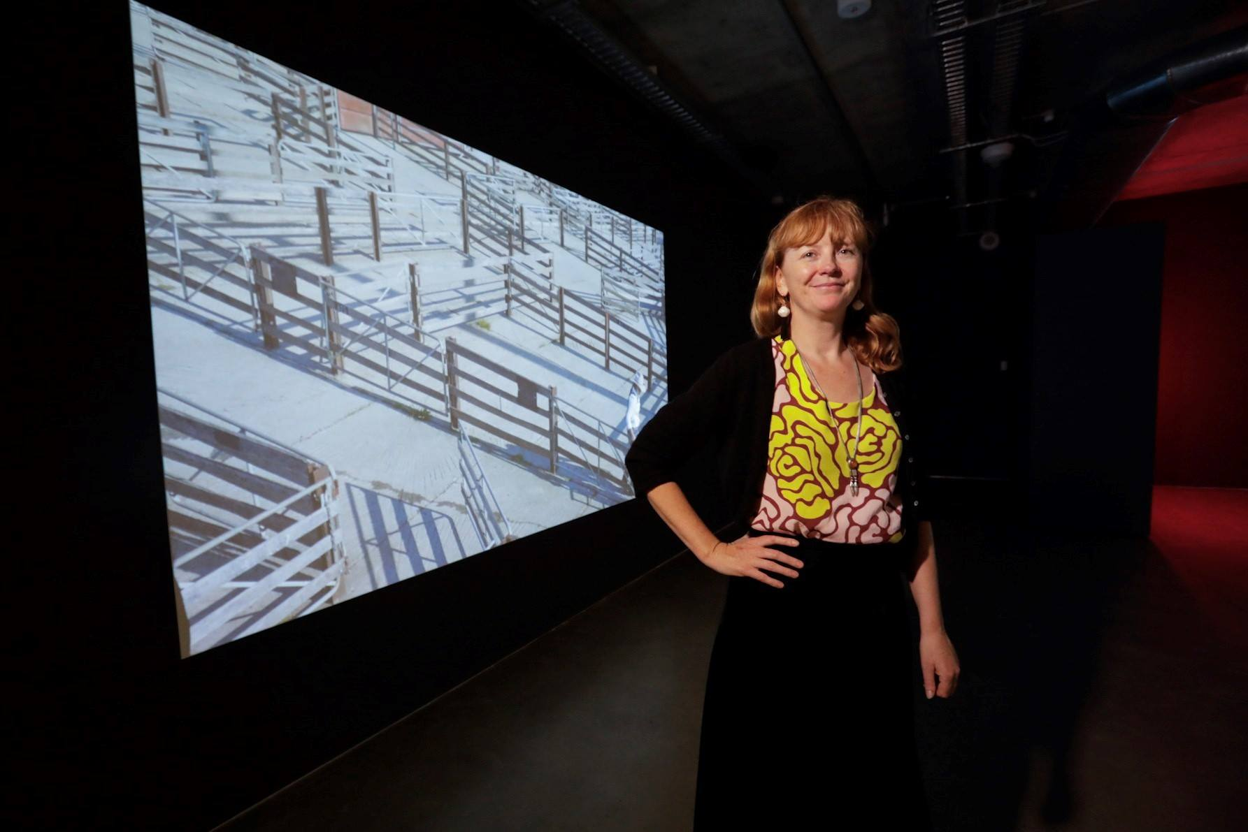 Image: Zanny Begg with her video work The Bullwhip Effect 2017, currently exhibited in the NSW Visual Arts Fellowship Exhibition at Artbank in Sydney. Photograph by Adam Amin @ Murray Harris Photography, courtesy of Create NSW.