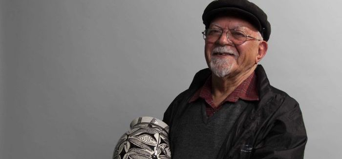 Uncle Vic Chapman holding the vase he made about his baagii (ABC/Tiger Webb)