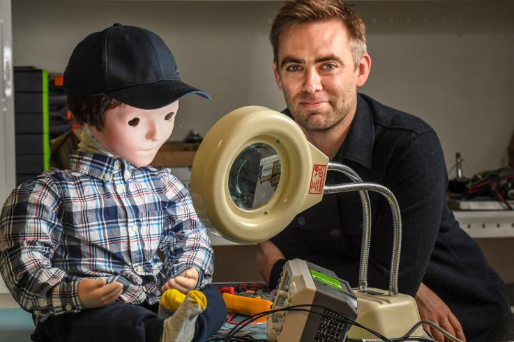Dr Scott Brown has used a social robot Kaspar to develop a framework to help autistic children recognise the emotions behind different facial expressions. Photo: UNSW