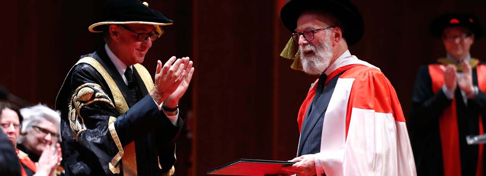 John Kaldor AO receives his honorary doctorate from UNSW Chancellor David Gonski AC.