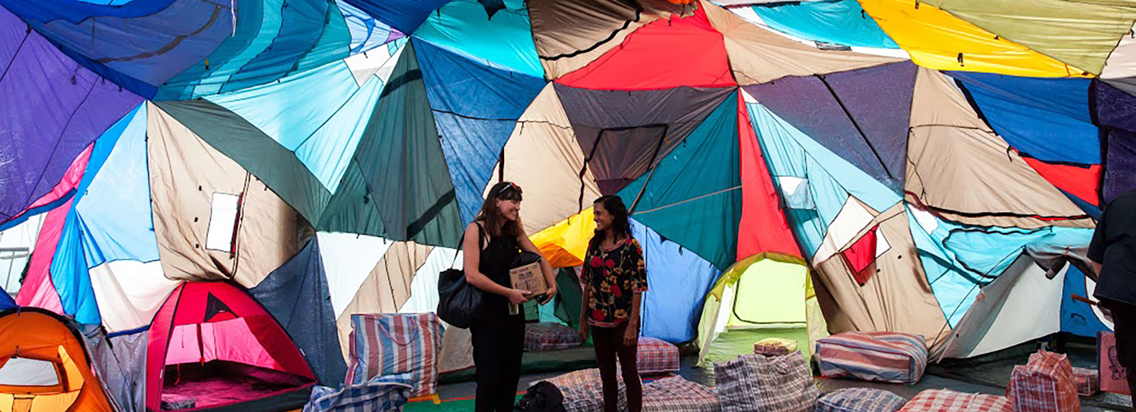 Keg de Souza, 'We Built This City', 2016, tents, tarps, hessian sacks, piping, plaid laundry bags, various found & recycled materials, dialogue, tour program, dimensions variable. Installation view of 20th Biennale of Sydney (2016). Courtesy the artist